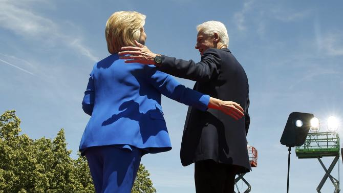 Hillary Clinton is joined onstage by her husband former President Clinton after delivering her