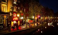 People walk through the red-light district, known as De Wallen, in Amsterdam, in 2011. A 527-year-old home that is believed to be the oldest in Amsterdam has been discovered in the red-light district, officials said Saturday (AFP Photo/Koen van Weel)