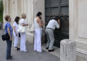 In this Sept. 7, 2013 photo, tourists look through…
