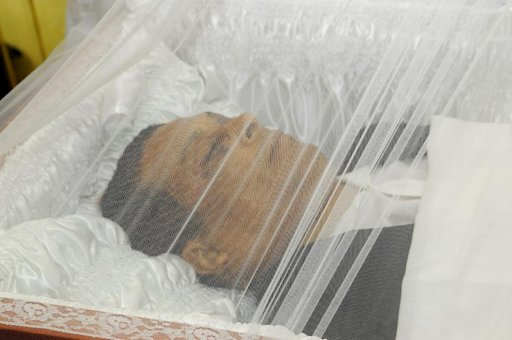 In this picture taken on Aug. 2, 2011, Dominican Republic's journalist Jose Agustin Silvestre is seen during his funeral in La Romana, Dominican Republic. Silvestre promised to reveal a bombshell in the next edition of his magazine, a story of drugs and corruption involving local businessmen, but he was kidnapped and killed on Aug. 2, 2011 before he could publish his expose. (AP Photo/Alberto Calvo)