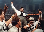 FILE - In this Jan. 1, 1983 file photo, Penn State head football coach Joe Paterno takes a victory ride from his players after defeating Georgia 27-23 in the Sugar Bowl NCAA college football game at the Supderdome in New Orleans, to win the national championship. On Sunday, Jan. 22, 2012, family says Paterno, winningest coach in major college football, has died. (AP Photo/File)