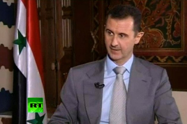 """In this image made from video, Syrian President Bashar Assad speaks with English-language television channel Russia Today recorded at an unknown date in Damascus, Syria. Assad vowed to """"to live in Syria and die in Syria"""", declaring in an interview broadcast Thursday, Nov. 8, 2012 that he will never flee his country despite the bloody, 19-month-old uprising against him. (AP Photo) RUSSIA OUT TV OUT"""