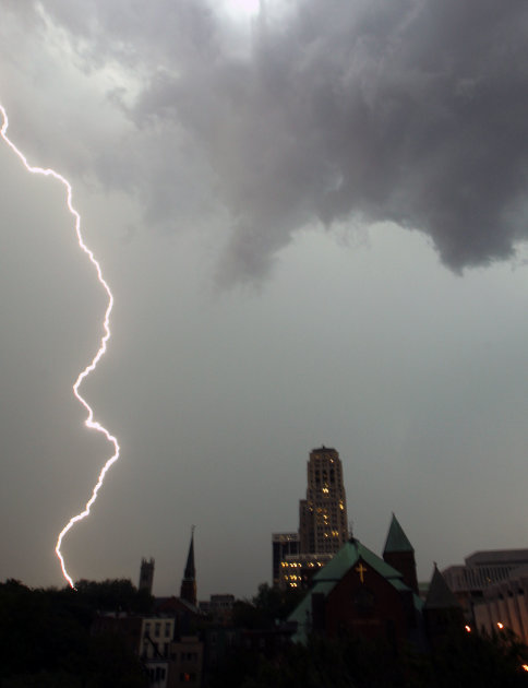 A lightning bolt touches down to the left of the Alfred E. Smith Building during a storm in Albany, N.Y., on Wednesday, June 8, 2011.   (AP Photo/Mike Groll)