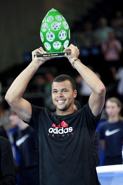 "Jo Wilfried Tsonga from France holds his trophy after defeating Ivan Ljubicic from Croatia in the final of the ATP ""Open de Moselle"" tennis tournament in Metz, eastern France, Sunday, Sept. 25, 2011. (AP Photo/Mathieu Cugnot)"