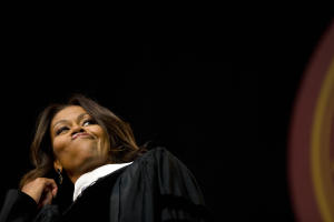 First lady Michelle Obama flips her hair after telling …