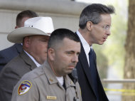 Law enforcement officials escort polygamist sect leader Warren Jeffs, right, out of the Tom Green County Courthouse Thursday, July 28, 2011, in San Angelo, Texas. A prosecutor told jurors Thursday he would present an audio recording of a polygamist sect leader raping a 12-year-old and other evidence showing the 55-year-old impregnated a 15-year-old girl during the man's sexual assault trial. (AP Photo/Tony Gutierrez)