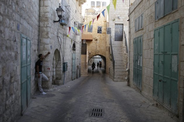 A Palestinian stands on a section of the path which tradition says Joseph and Mary took into the Bethlehem in their trek from Nazareth 2, 000 years ago