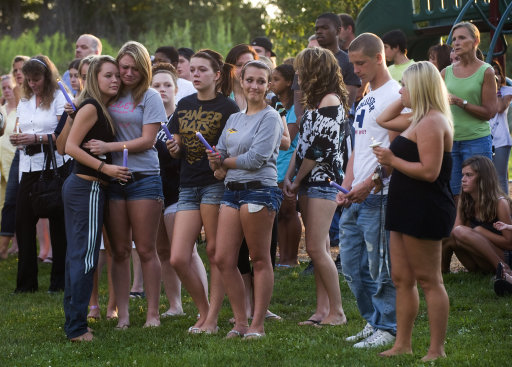 Several hundred people attend a prayer vigil, following a  multiple death shooting in Copley Twp. a suburb of Akron, Ohio, Sunday, Aug. 7. 2011. A man apparently angry with his girlfriend gunned down two people outside an Ohio home in Copley Twp., Sunday, and two more in a car, then shot his girlfriend in a rampage that left eight dead including the gunman.  (AP Photo/Phil Long)