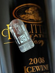 A picture taken on July 7 in Bordeaux, southwestern France shows a seal on a bottle of wine. The seals -- developed by Prooftag, a French firm that specialises in brand security -- is among several technologies that vintners are embracing to foil fraudsters and reassure consumers that they are buying the real thing