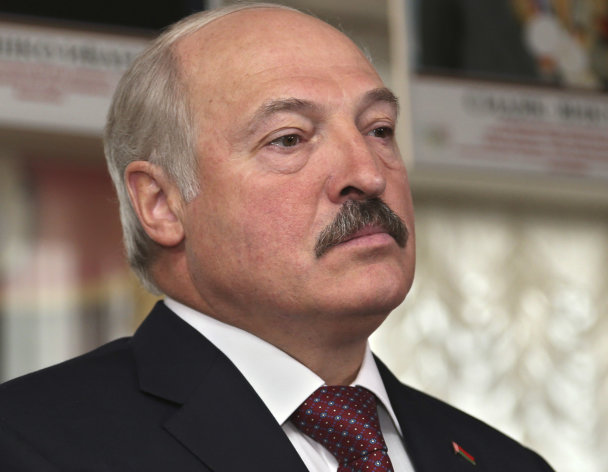 Belarusian President Alexander Lukashenko, at a polling station during parliamentary elections in Minsk, Belarus, Sunday, Sept. 23, 2012. Belarus is holding parliamentary elections Sunday without the main opposition parties, which boycotted the vote to protest the detention of political prisoners and opportunities for election fraud. (AP Photo/Sergei Grits)
