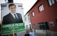 A man walks past an election poster of Democratic Action Party candidate Hamdija Fejzic in Srebrenica, October 6, 2012. Bosnians will vote on Sunday in local elections likely to keep in power nationalist parties reflecting ethnic rivalries, 17 years after war ended. REUTERS/Dado Ruvic