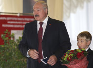 Belarusian President Alexander Lukashenko arrives with his youngest son Nikolai at a polling station during parliamentary elections in Minsk, Belarus, Sunday, Sept. 23, 2012. Belarus is holding parliamentary elections Sunday without the main opposition parties, which boycotted the vote to protest the detention of political prisoners and opportunities for election fraud. (AP Photo/Sergei Grits)