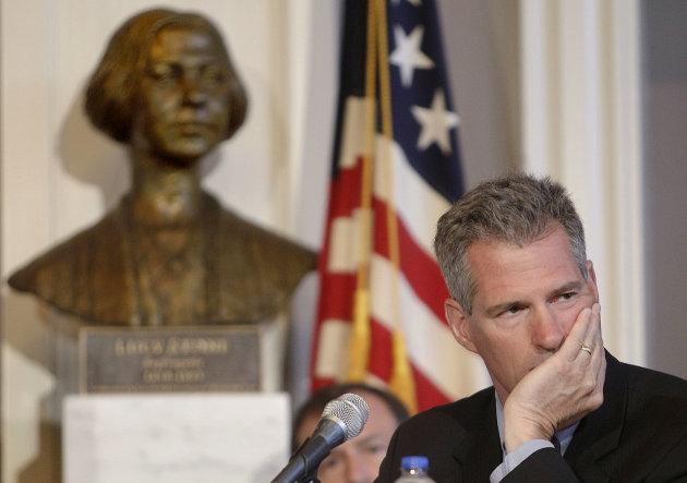 Sen. Scott Brown, R-Mass., waits for a hearing of the Senate Federal Financial Management, Government Information, Federal Services and International Security subcommittee hearing at historic Faneuil Hall in Boston, Monday, June 20, 2011. (AP Photo/Stephan Savoia)