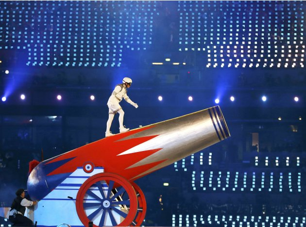 A performer prepares to climb into a giant cannon at the closing ceremony of the London 2012 Olympic Games at the Olympic Stadium