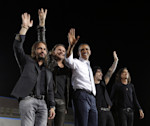 President Barack Obama, center, on stage with members of the Mexican pop rock band Mana, during a campaign event in Desert Pines High School, Sunday, Sept. 30, 2012 in Las Vegas. With Obama are from ...