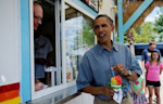 US President Barack Obama eats shaved ice at Tropical Sno in Denison, Iowa