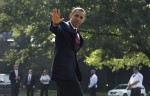 U.S. President Barack Obama waves as he walks on the South Lawn of the White House in Washington