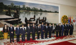 U.S. President Barack Obama, eighth from left, smiles as he stands with other leaders for a group photo at the East Asia Summit in Phnom Penh, Cambodia, Tuesday, Nov. 20, 2012. They are, from left ...