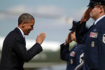 U.S. President Barack Obama salutes as he steps aboard Air Force One at Andrews Air Force Base near Washington