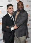 """Efron arrives with director Daniels for the gala presentation of """"The Paperboy"""" during the Toronto International Film Festival"""