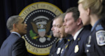 President Barack Obama greets first responders after speaking in the South Court Auditorium of the Eisenhower Executive Office building on the White House complex in Washington, Tuesday, Feb. 19 ...