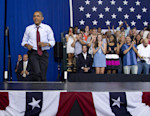 President Barack Obama arrives at a campaign event, Saturday, Aug. 18, 2012, in Windham, N.H., at Windham High School. As they rush towards their party conventions, the rival presidential campaigns ...