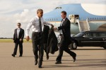 U.S. President Barack Obama removes his jacket as he arrives in Tampa