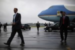 U.S. President Barack Obama walks on the tarmac upon his arrival in Swanton, Ohio