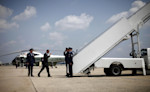 President Barack Obama prepares to board Air Force One before his departure from Andrews Air Force Base, Md.,Thursday, Aug., 2, 2012. Obama is campaigning in Florida and Northern Virginia today. (AP ...