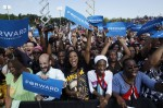 Supporters of U.S. President Obama cheer as President Obama attends a campaign rally in Woodbridge