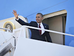 President Barack Obama waves as he boards Air Force One before his departure from Andrews Air Force Base, Md., Friday, Aug., 31, 2012. Obama is traveling to Fort Bliss in Texas to meet with members ...