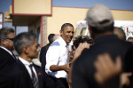 U.S. President Obama greets residents outside Romero's Cafe in Pueblo