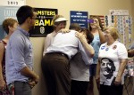 U.S. President Barack Obama hugs a volunteer during a visit to a local Obama campaign office in Henderson