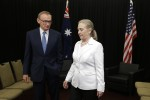 U.S. Secretary of State Hillary Clinton and Australian Foreign Minister Bob Carr exit a room after posing for photographs in Perth