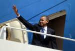 U.S. President Barack Obama waves from the steps of Air Force One at Andrews Air Force Base near Washington