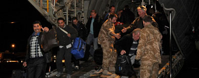Cvilians disembark from a Royal Air Force C130 Hercules in Maltas. (Associated Press/Paul Randall)