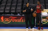 Miami Heat head coach Erik Spoelstra (L) speaks to Dwyane Wade during a team practice for the NBA basketball finals in Oklahoma City, Oklahoma, June 13, 2012. REUTERS/Jim Young
