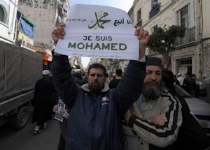 """An Algerian protestor holds a sign reading """"I…"""
