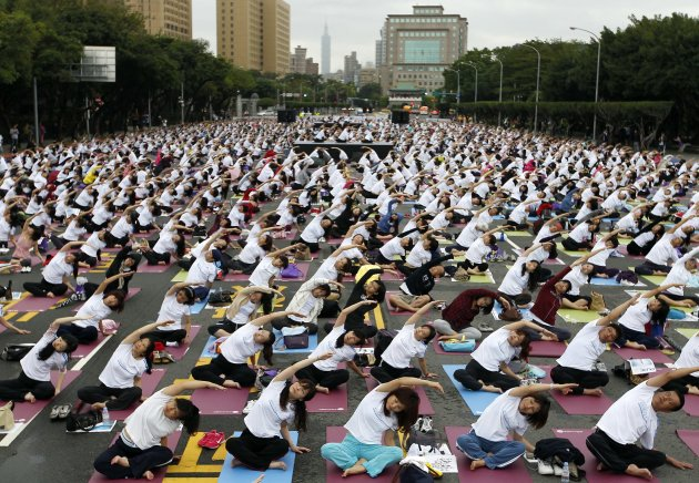 People practice yoga in front of the Presidential Office in Taipei