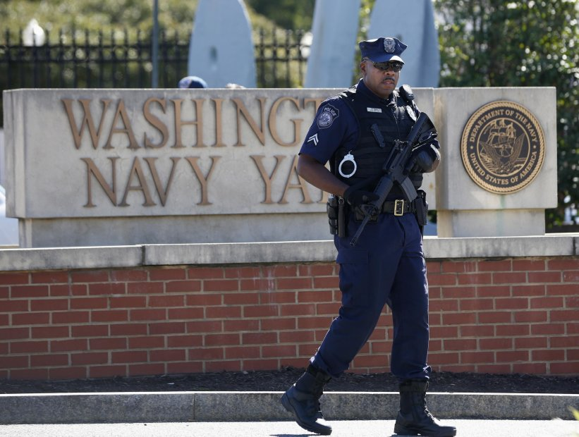 A police officer stands at the main gate of the Washington Navy Yard in Washington