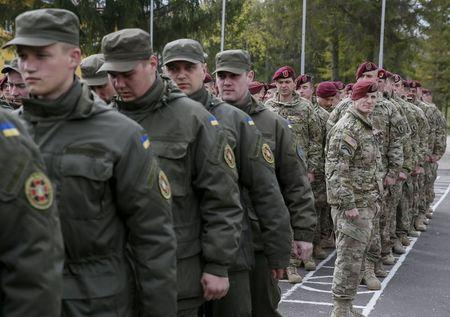 Servicemen of 173rd Airborne Brigade Combat Team of the U.S. Army and Ukrainian National Guard attend an opening ceremony of joint military exercise &...