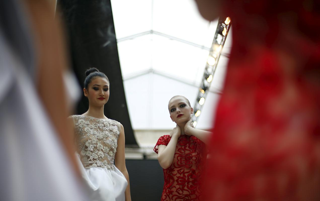 Models line up backstage before Nadir Tati show during Lisbon Fashion Week