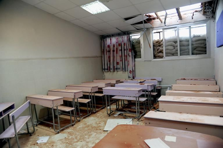 A picture released on November 11, 2013 said to show debris at a classroom in the St. John of Damascus school after it was hit with mortar rounds (AFP Photo/)