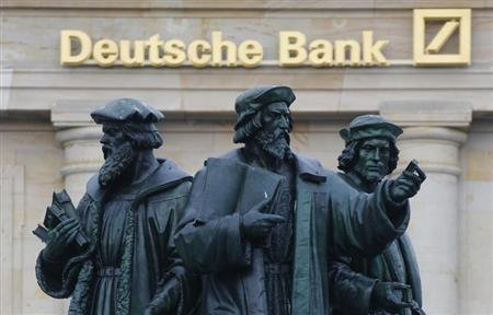A statue is pictured in front of the former head quarters of Germany's largest business bank, Deutsche Bank in Frankfurt, January 28, 2013. REUTERS/Kai Pfaffenbach