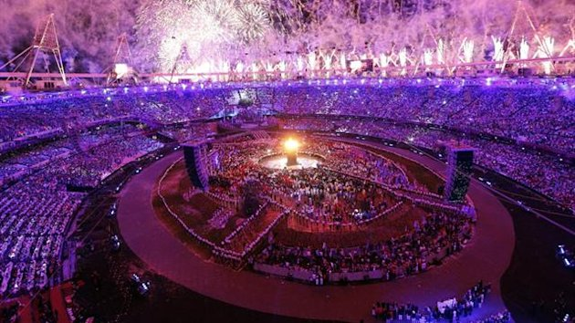 The Olympic cauldron is seen alight as fireworks are set off during the opening ceremony of the London 2012 Olympic Games (Reuters)