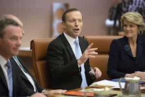 New Australian Prime Minister Tony Abbott (C) chairs …