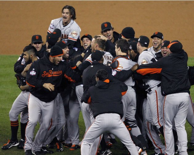 San Francisco Giants players celebrate after defeating the Detroit Tigers to win the MLB World Series baseball championship in Detroit