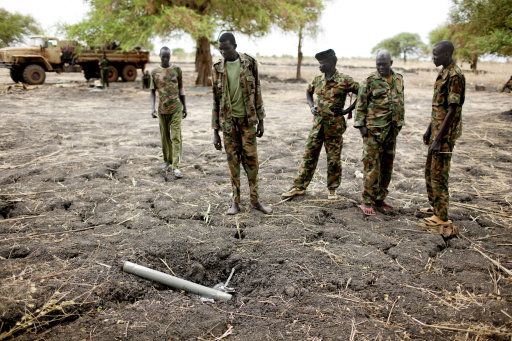 Sudan<br /><br /><br /><br /><br /><br /><br /><br /><br />  People's Liberation Army (SPLA) soldiers inspect ordinance dropped by the Sudan Armed Forces (SAF) at a frontline position in Pana Kuach, Unity State, South Sudan. SAF forces regularly employ air strikes, a capability that southern forces lack. In late April, tensions between Sudan and South Sudan erupted into armed conflict along their poorly defined border. Thousands of SPLA forces have been deployed to Unity State where the two armies are at a tense stalemate around the state's expansive oil fields. Fighting between the armies lulled in early May after the U.N. Security Council ordered the countries to resume negotiations. South Sudan seceded from the Republic of Sudan in July 2011 following decades of civil war. (AP Photo/Pete Muller)