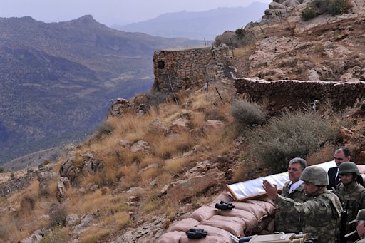 Turkey's President Abdullah Gul listens to an army officer at a military post during his visit to troops in the Hakkari province in southeastern Turkey