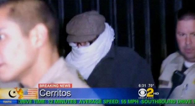FILE - In this Sept. 15, 2012 file image from video provided by CBS2-KCAL9, Nakoula Basseley Nakoula, the man behind a crudely produced anti-Islamic video that has inflamed parts of the Middle East, is escorted by Los Angeles County sheriff's deputies from his home in Cerritos, Calif. Nakoula, 55, was arrested Thursday for violating terms of his probation, authorities said. (AP Photo/CBS2-KCAL9, File) MANDATORY CREDIT CBS-KCAL9, LOS ANGELES OUT, LOS ANGELES TV OUT